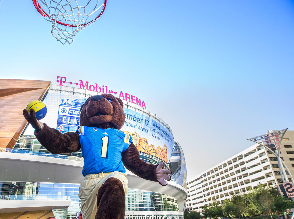UCLA mascot Joe Bruin drives for a layup on Tuesday, Oct. 11, 2016, outside T-Mobile Arena, in ...