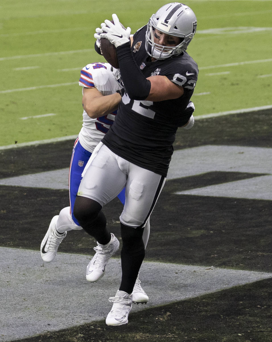 Las Vegas Raiders tight end Jason Witten (82) makes a touchdown catch over Buffalo Bills outsid ...