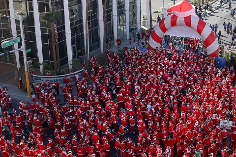 People get ready to start in the 14th annual Las Vegas Great Santa Run in downtown Las Vegas, D ...