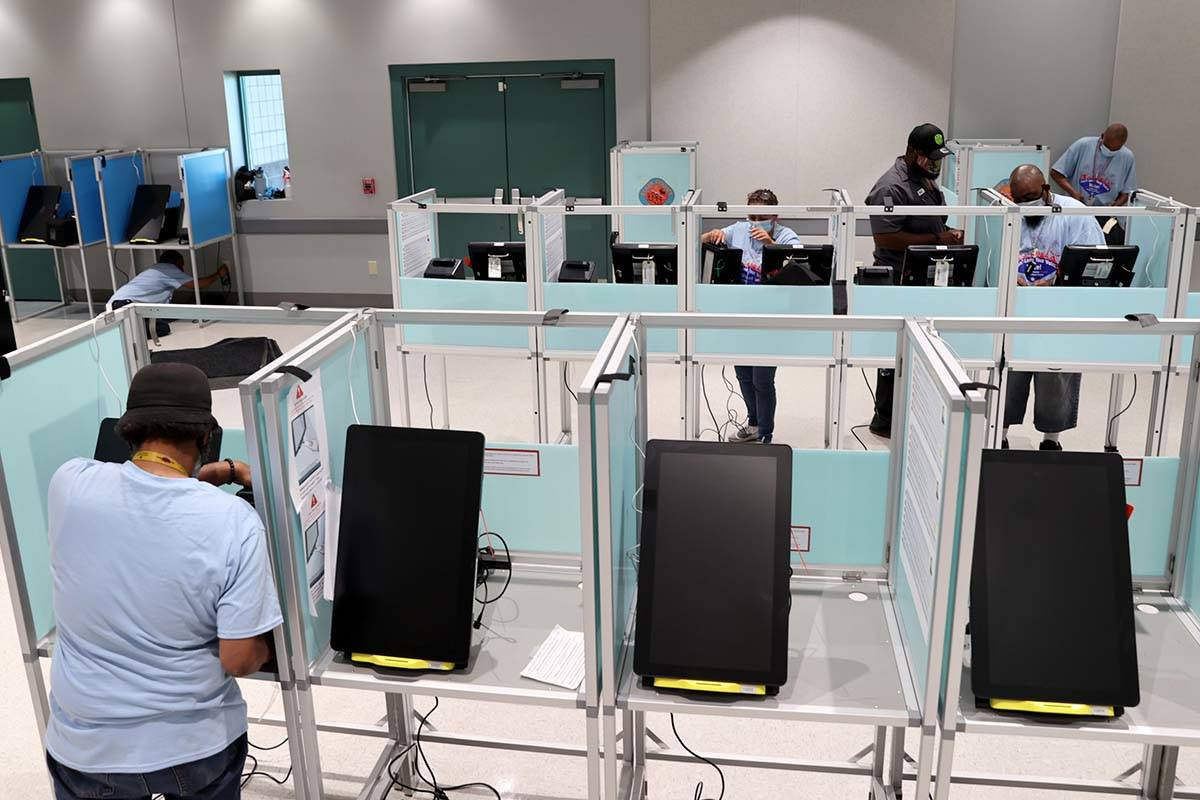 Clark County election workers set up voting booths at the Cora Coleman Senior Center in Las Veg ...