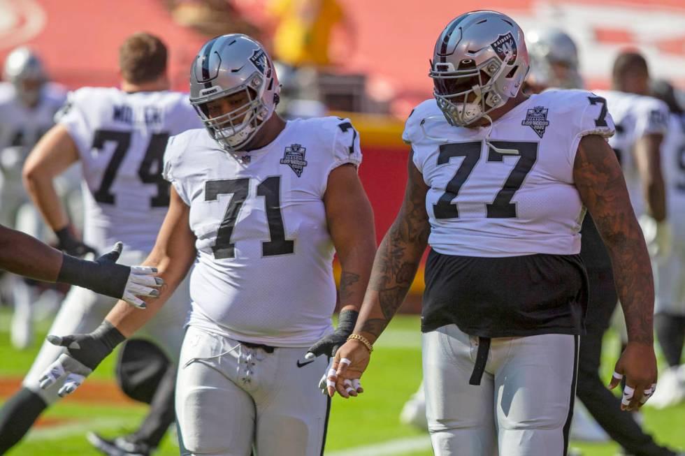 Las Vegas Raiders offensive tackle Denzelle Good (71) and Las Vegas Raiders offensive tackle Tr ...