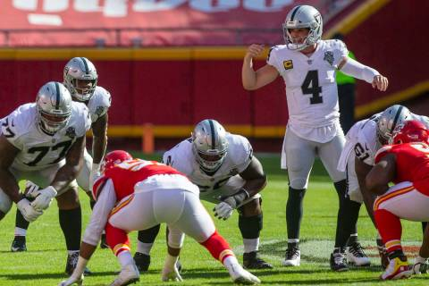 Las Vegas Raiders quarterback Derek Carr (4) audibles a play as offensive linemen Trent Brown ( ...
