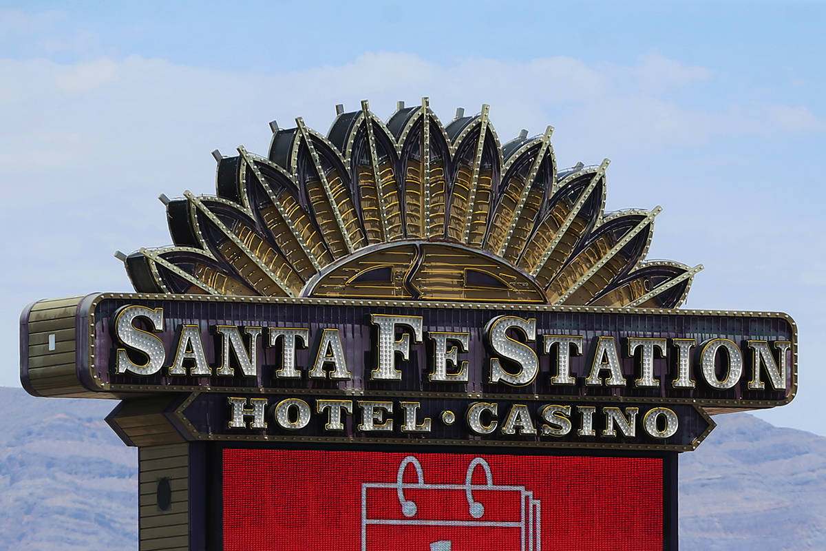 A marquee announces the reopening at Santa Fe Station hotel-casino in Las Vegas, Wednesday, Jun ...