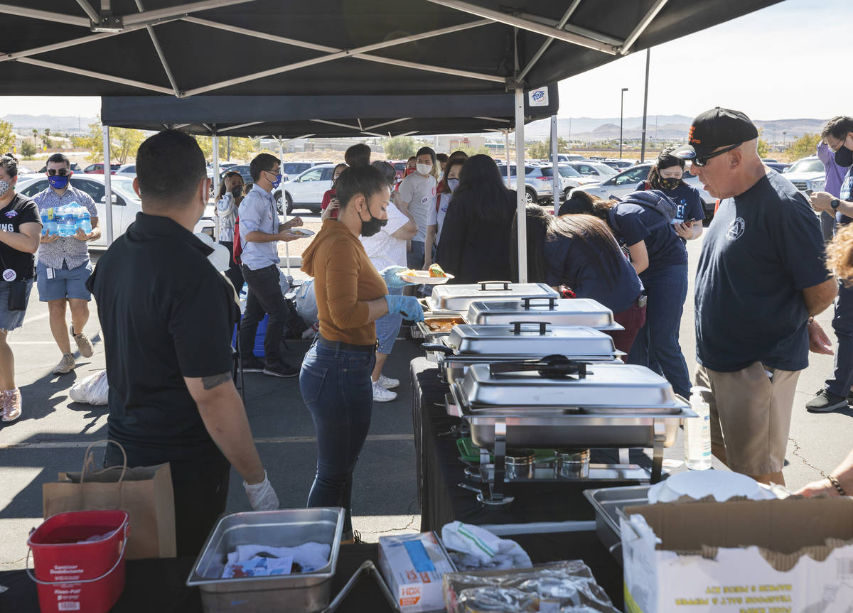 Individuals are served fee food at the Desert Breeze Community Center polling site, on Saturday ...