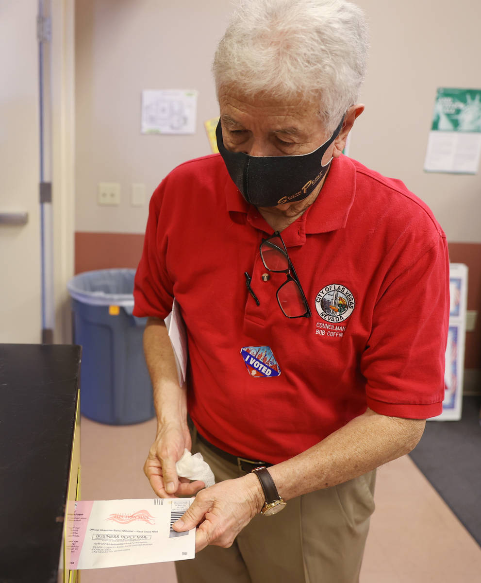 Former Councilman Bob Coffin drops off his ballot at the East Las Vegas Community Center pollin ...