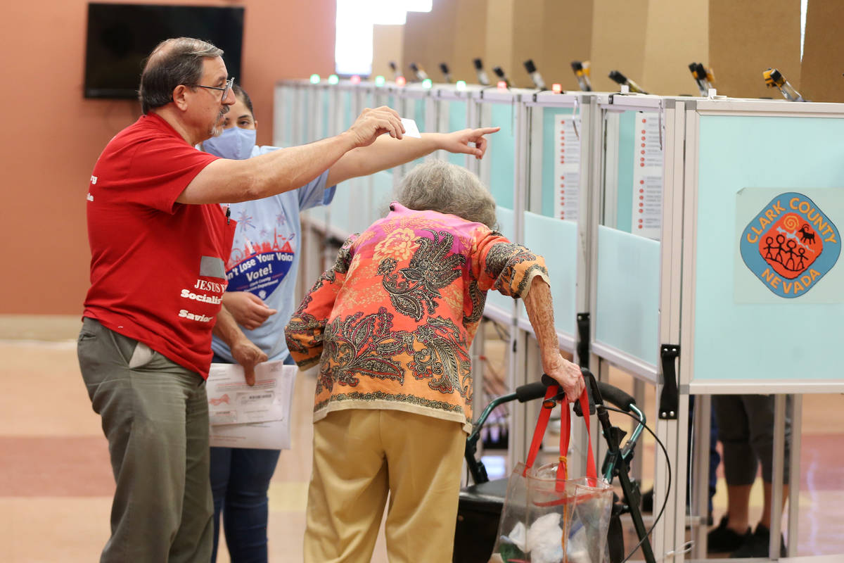 Kim Blandino, left, and Evelyn Pendergraft, receive assistance from poll monitor Yobana Gracian ...