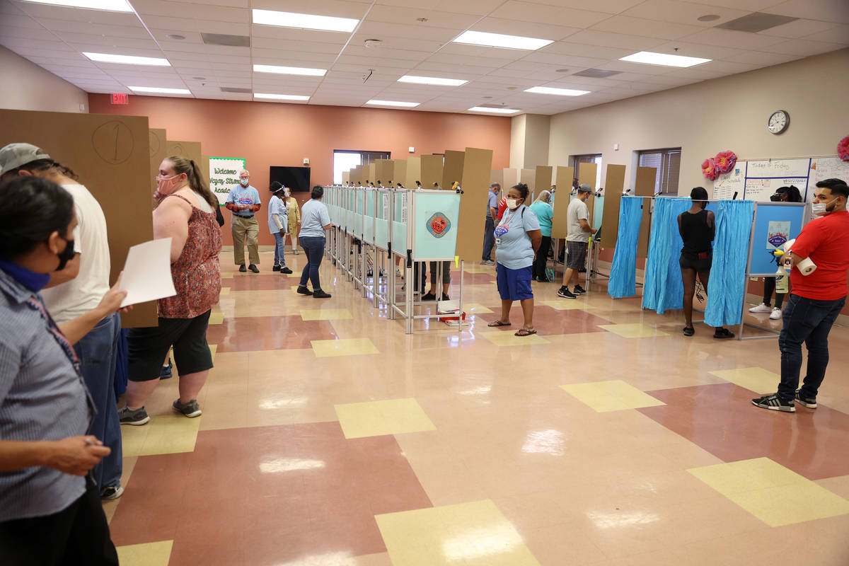 People cast their votes inside of the East Las Vegas Community Center polling location in Las V ...