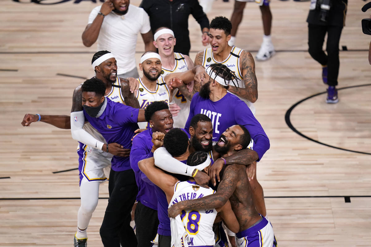 The Los Angeles Lakers players and coaches celebrate after the Lakers defeated the Miami Heat 1 ...