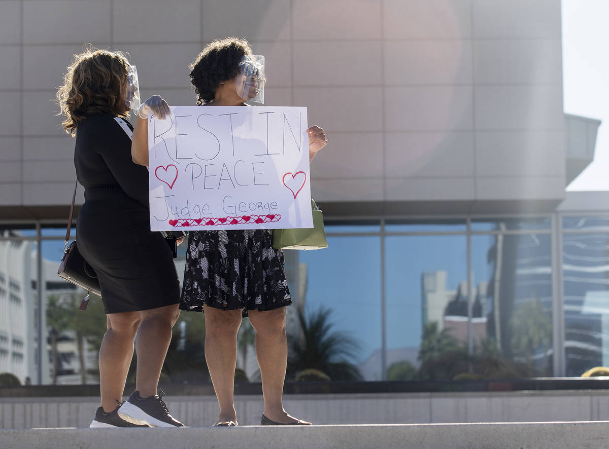 Traci Rawlinson, left, and her mother Judge Johnnie B. Rawlinson pay respects as a police-escor ...