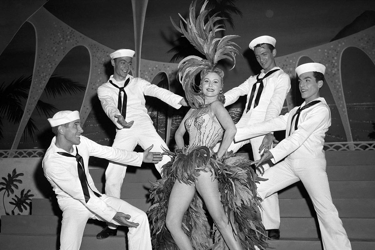 FILE - In this May 20, 1957 file photo, Actress Rhonda Fleming blossoms out as a singer and dan ...