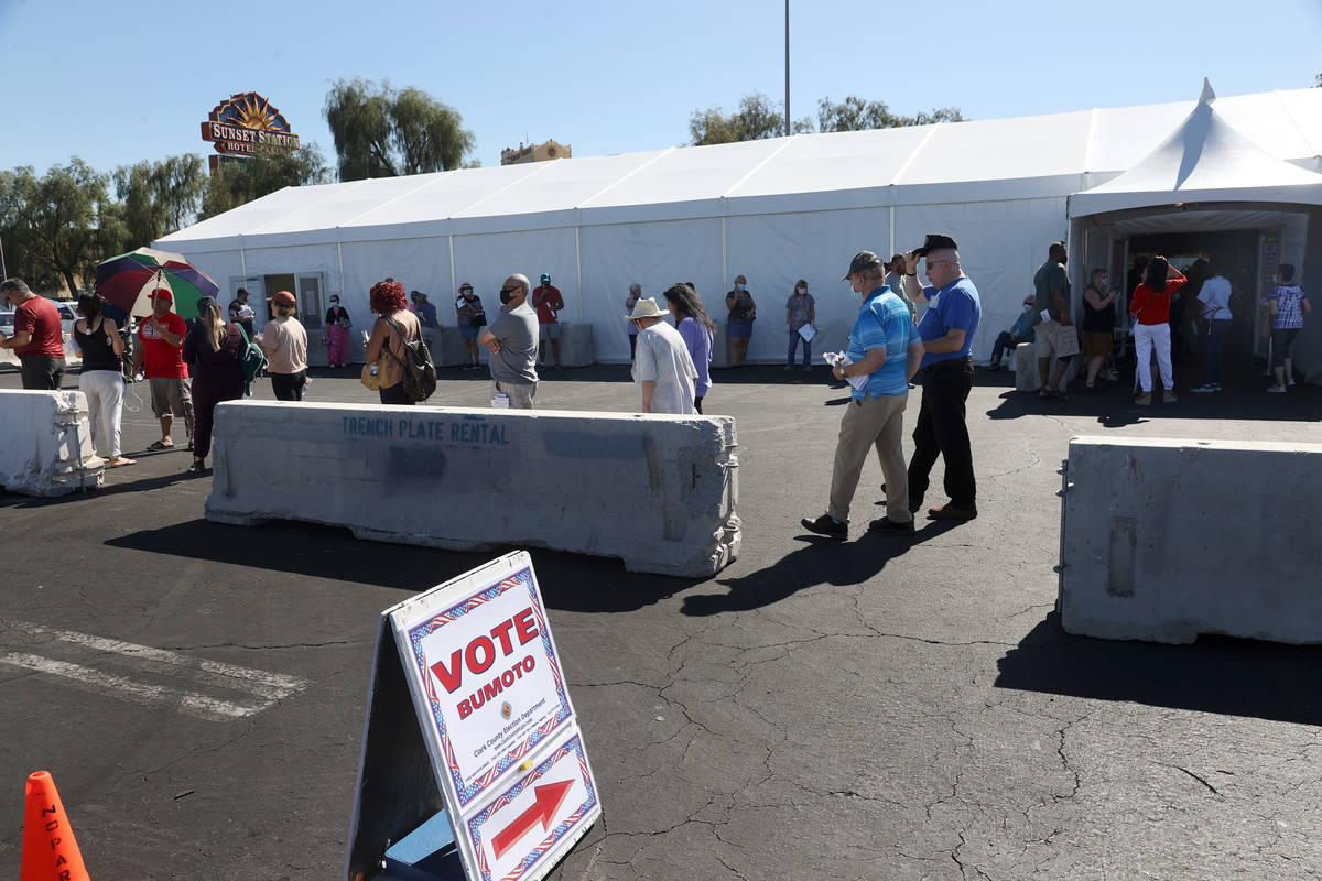 People wait in line to cast their votes at the Galleria at Sunset polling location in Henderson ...