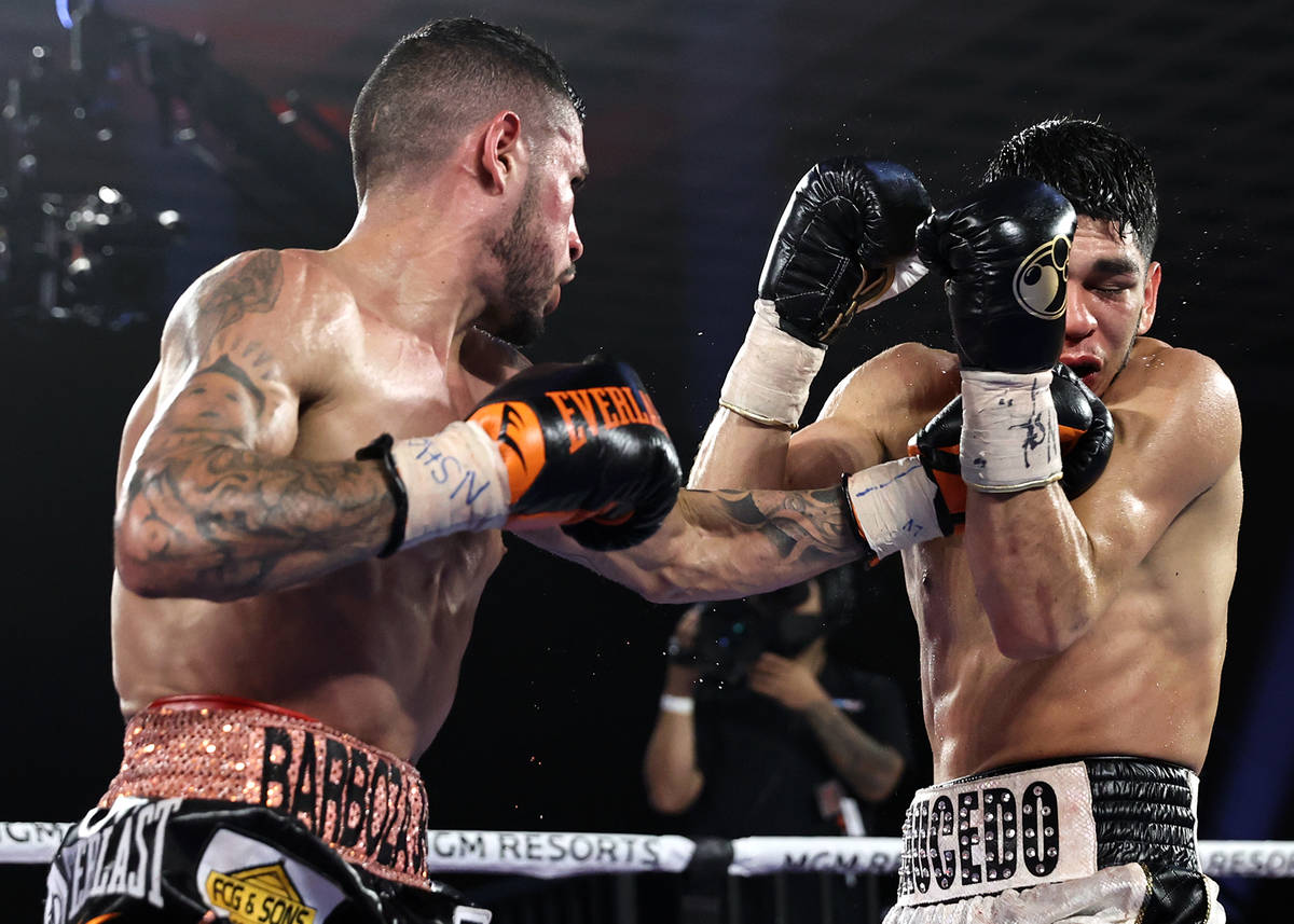 Arnold Barboza Jr., left, lands a punch against Alex Saucedo during their junior welterweight f ...