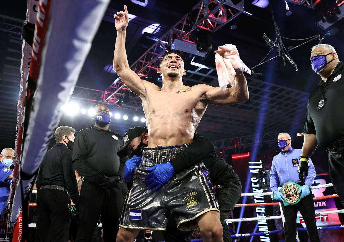 Teofimo Lopez celebrates after winning a unanimous decision over Vasiliy Lomachenko in their li ...