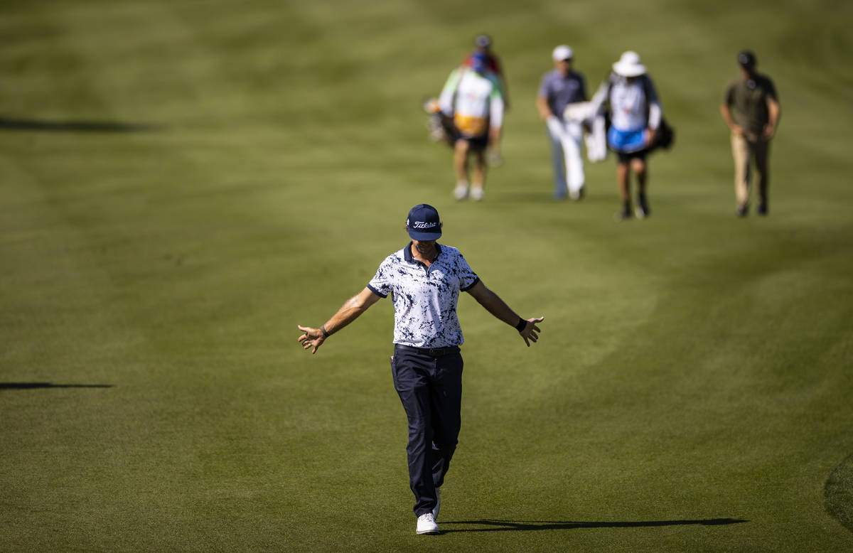 Lanto Griffin stretches his arms while walking to the fourth green during the final round of th ...