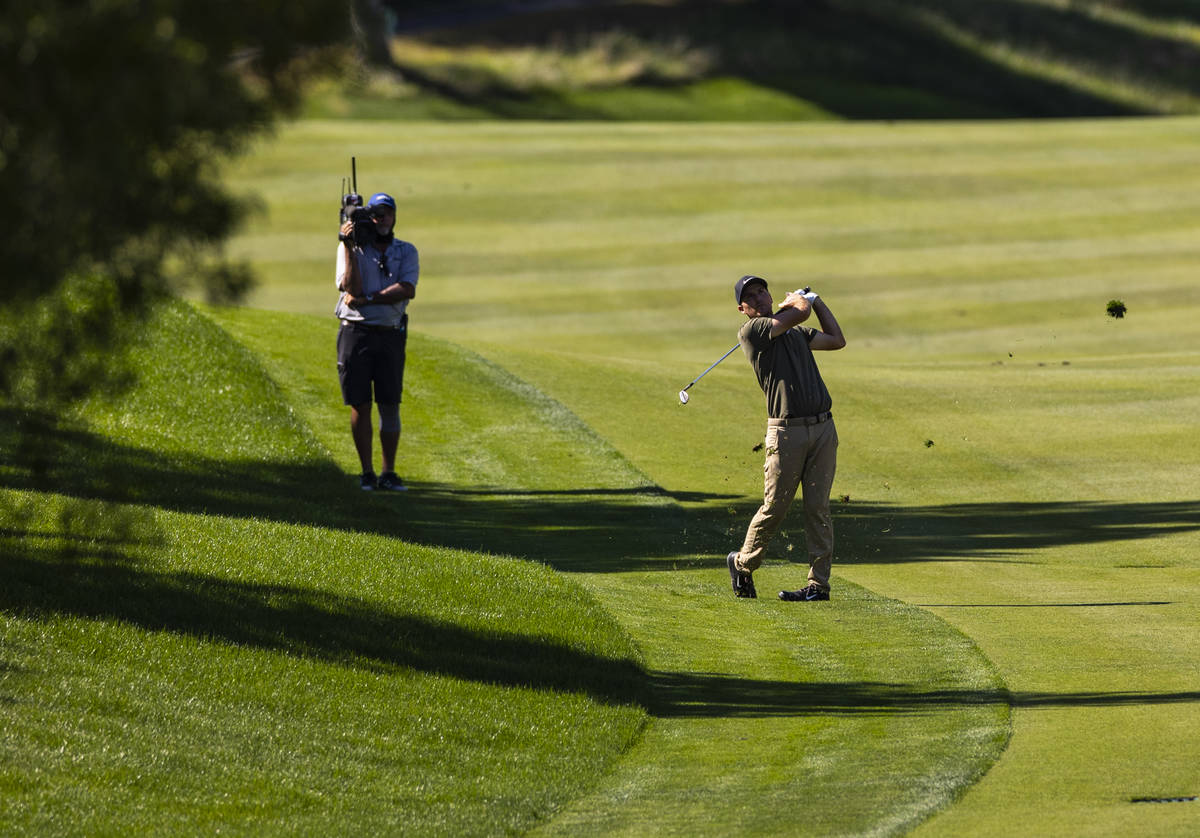 Russell Henley hits a fairway shot at the seventh hole during the final round of the CJ Cup at ...