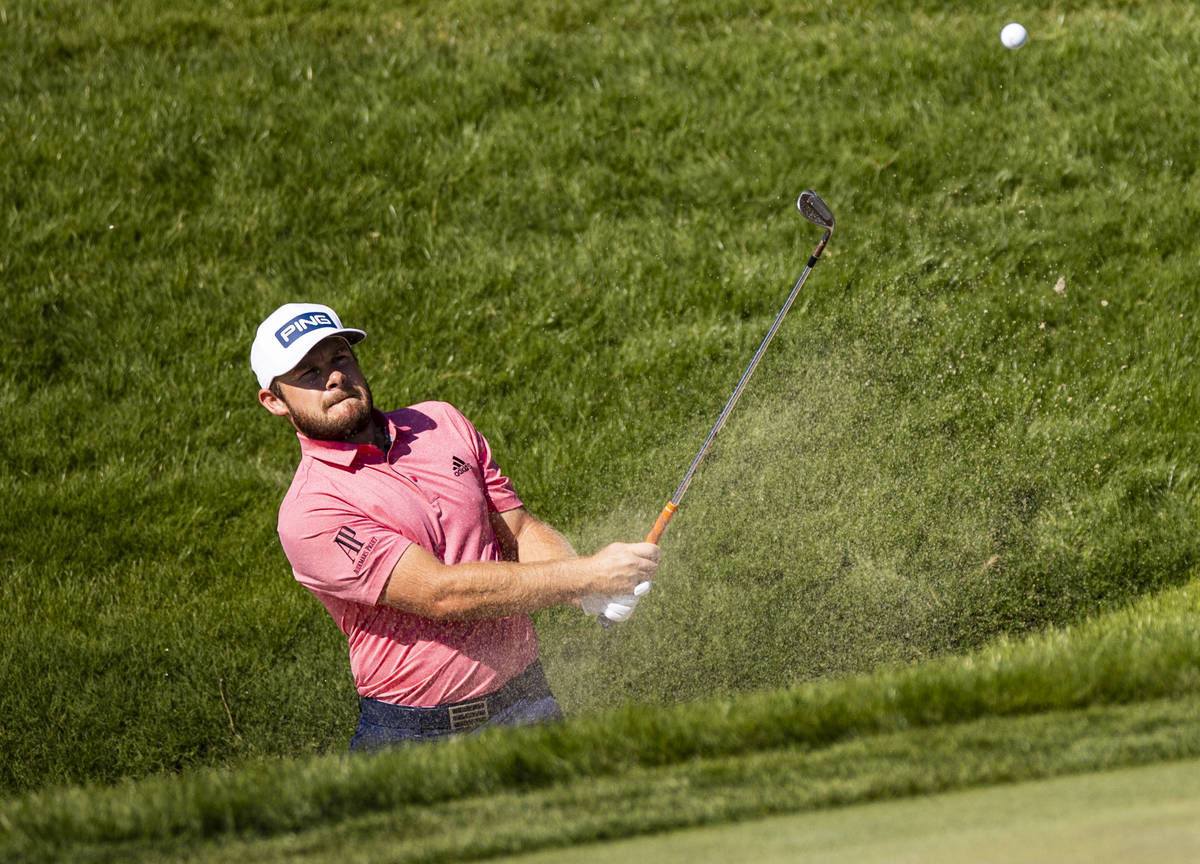 Tyrrell Hatton hits out of the bunker onto the seventh green during the final round of the CJ C ...
