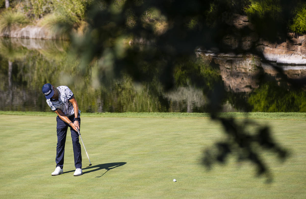 Lanto Griffin putts on the fourth green during the final round of the CJ Cup at the Shadow Cree ...