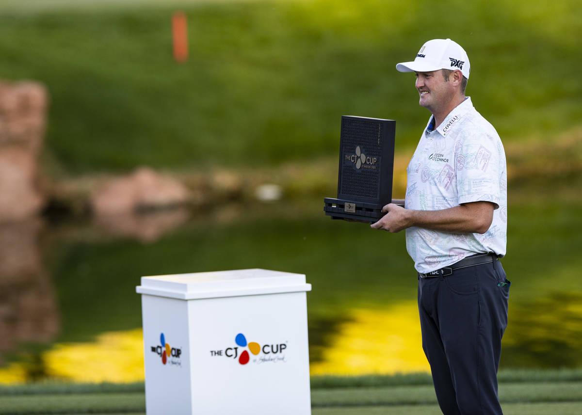 Jason Kokrakʣelebrates with the trophy after winningʴhe CJ Cup at the Shadow Creek ...