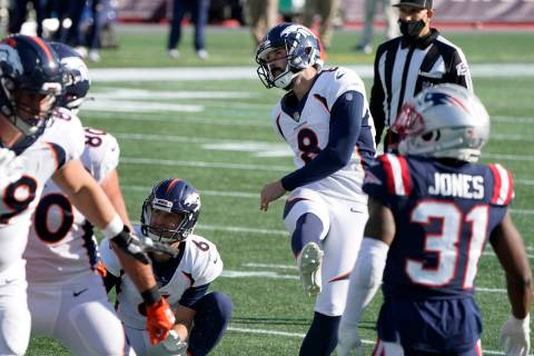 Denver Broncos place kicker Brandon McManus (8) follows through on one of his six field goals a ...