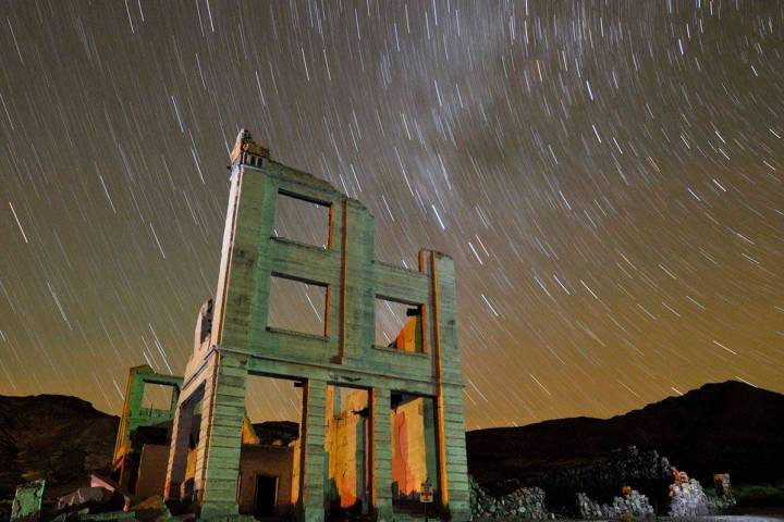Ruins of the Cook Bank building in Rhyolite, Nev., is shown in this time exposure beneath a cel ...