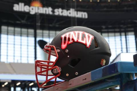 A UNLV football helmet is seen inside Allegiant Stadium, where the team will play its home game ...