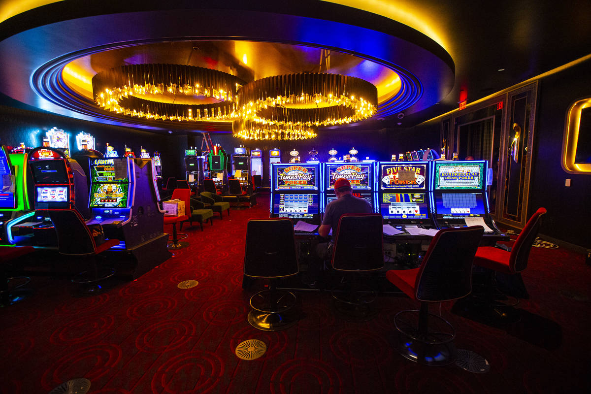 Slot machines are prepared inside the high limit gaming area during a tour of Circa, the first ...