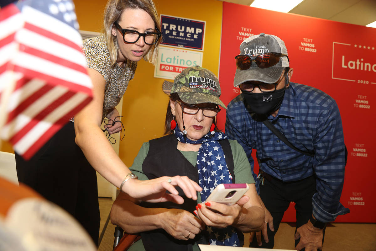 Amanda Flocchini, from left, strategic initiatives director for the Nevada Republican Party, as ...