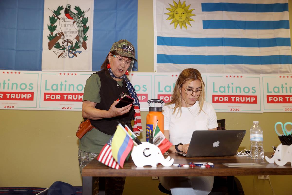 Carolina Serrano, right, Hispanic engagement coordinator for the Nevada Republican Party, assis ...