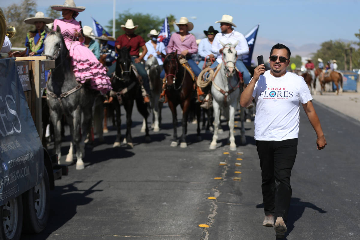 Assemblyman Edgar Flores leads a campaign parade to promote the Latino vote near the Walnut Com ...