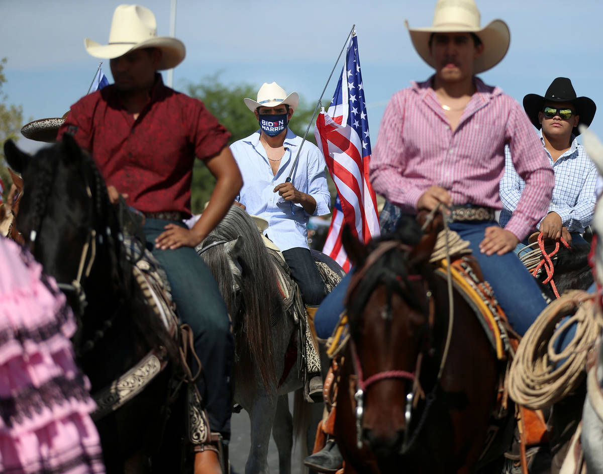 Horseback riders participate during a campaign parade for Assemblyman Edgar Flores and the Bide ...
