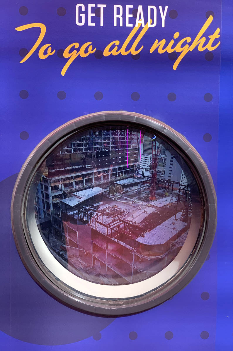 A porthole outside Circa, the new hotel-casino by owners Derek and Greg Stevens, displays a vid ...