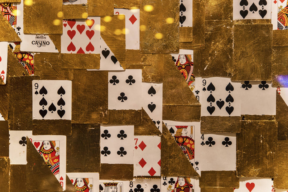 Gambling-themed art lines the walls of the high limit gaming area at Circa on Monday, Oct. 19, ...