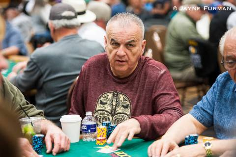 Sam Grizzle plays in the $1,000 buy-in Super Seniors No-limit Hold'em event at the World Series ...