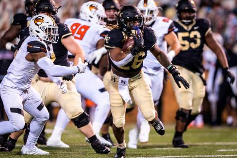 Wake Forest running back Christian Beal-Smith (26) carries against Campbell during an NCAA coll ...
