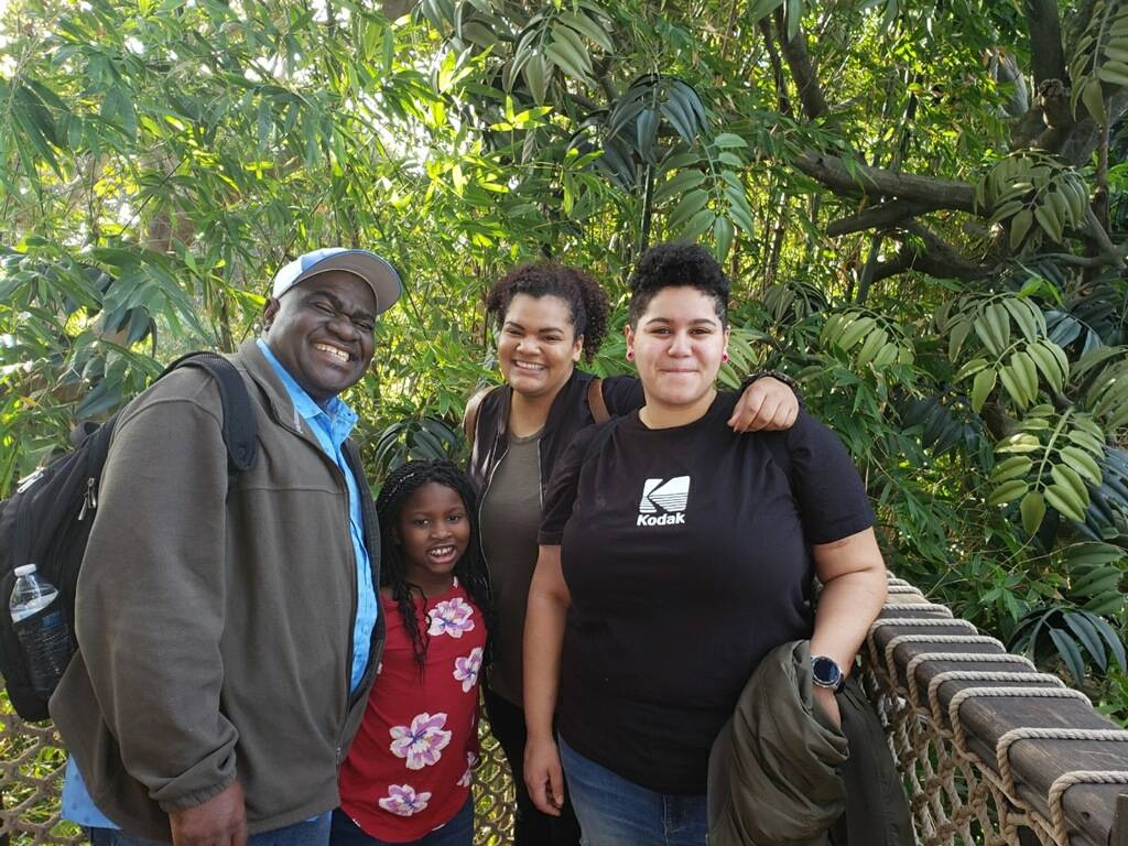 Peter Umoh with his children Enobong, Didi and Abasi. (The Umoh family)