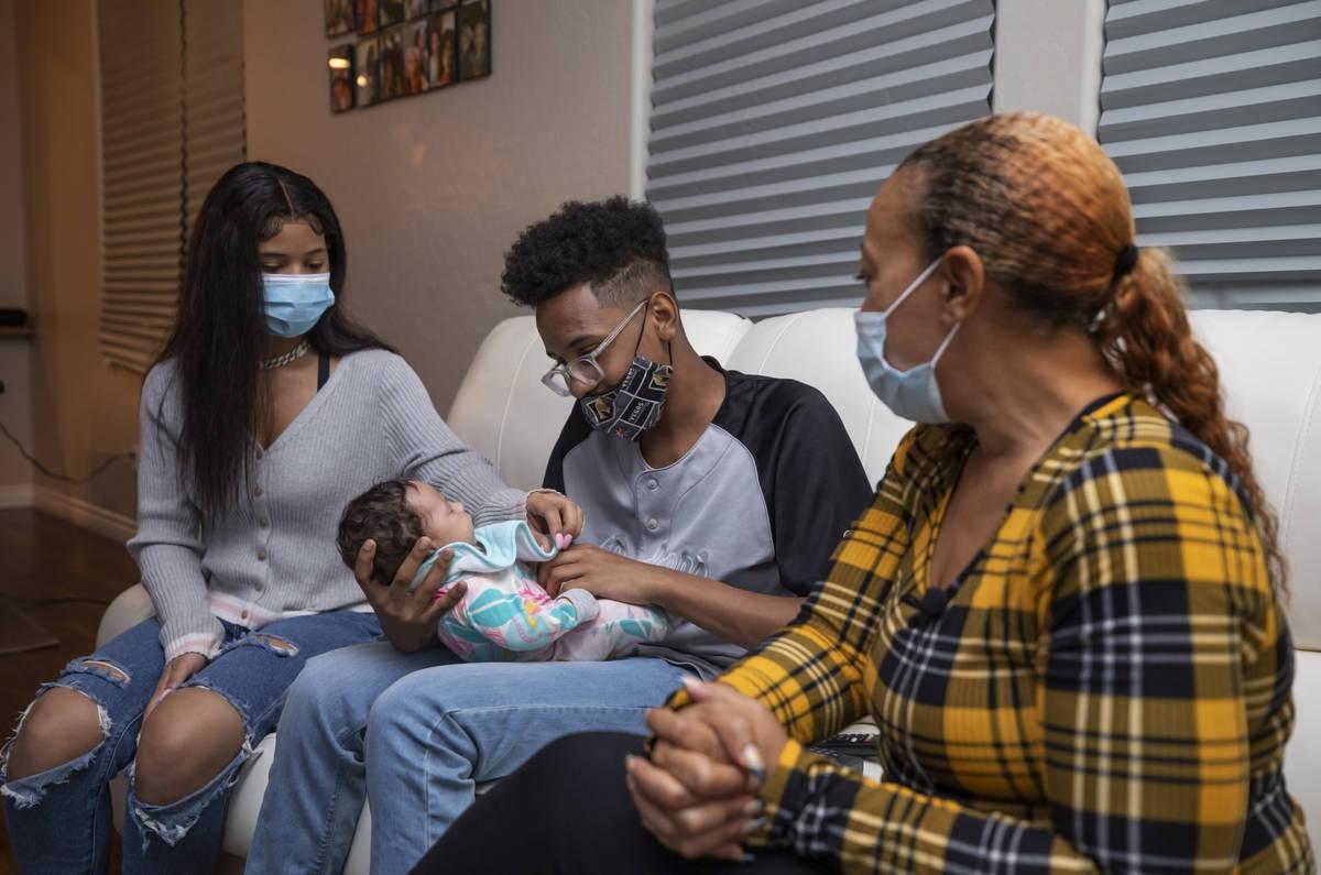 From left, Ebonee Levi, 17, Tavaras Chandler Jr., 14, holding 2-month old Zoie Chandler, and Da ...