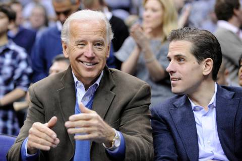 Vice President Joe Biden, left, with his son Hunter, right, talk during the Duke-Georgetown NCA ...