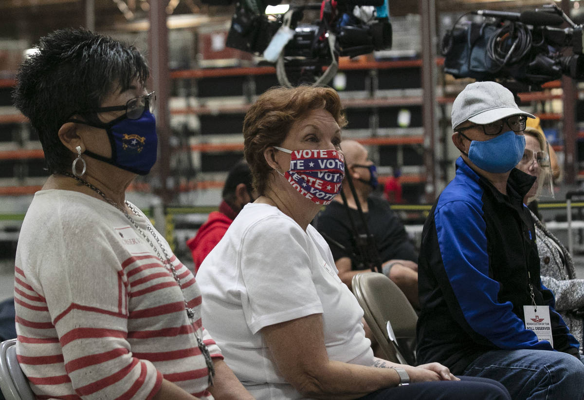 Election observers, Michelle Barnes, left, Donna West, and Raul Sabido, right, watch as Clark C ...