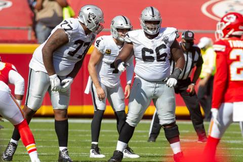 Las Vegas Raiders offensive tackle Trent Brown (77) communicates with offensive guard Gabe Jack ...