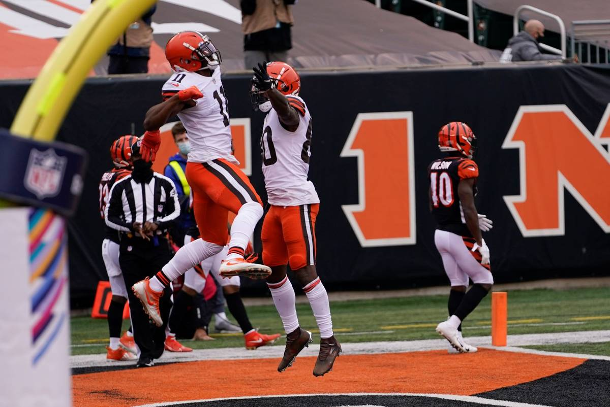 Cleveland Browns' Donovan Peoples-Jones (11) celebrates his touchdown reception with Jarvis Lan ...
