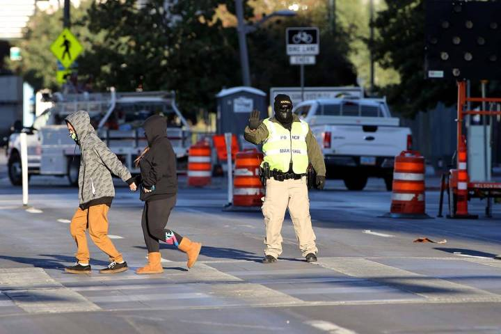 Deputy Marshal, David Muhr is bundled up for the chilly weather as he stops traffic for pedestr ...