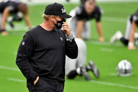 Las Vegas Raiders coach Jon Gruden on the field before an NFL football game between the Las Veg ...