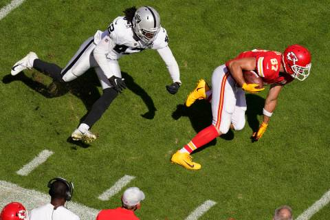 Kansas City Chiefs tight end Travis Kelce (87) runs from Las Vegas Raiders inside linebacker Co ...