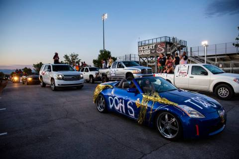 Desert Oasis High School students participate in a senior prom parade in Las Vegas on Friday, M ...