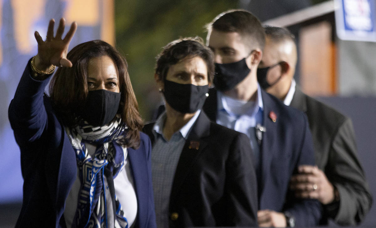 Vice presidential candidate Sen. Kamala Harris waves goodbye to the audience following her camp ...