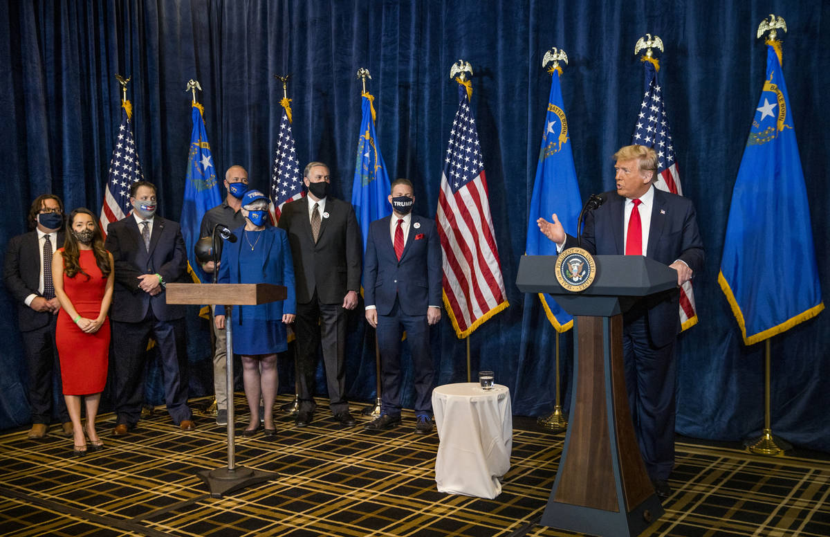 President Donald Trump answers a reporterÕs question on a recent shooting during a press c ...