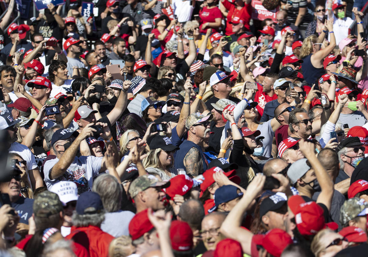 Supporters cheer as President Donald Trump speaks during Make America Great Again victory rally ...