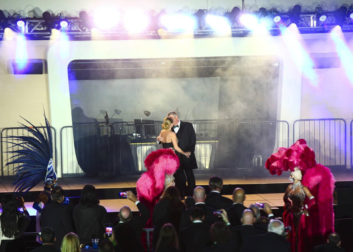 Circa owner Derek Stevens kisses his wife, Nicole, at Stadium Swim during the VIP black-tie gra ...