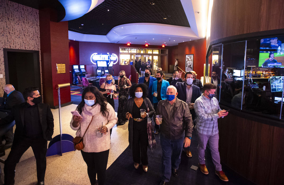 People head to the casino floor at Circa as it opens to the public just after midnight in downt ...