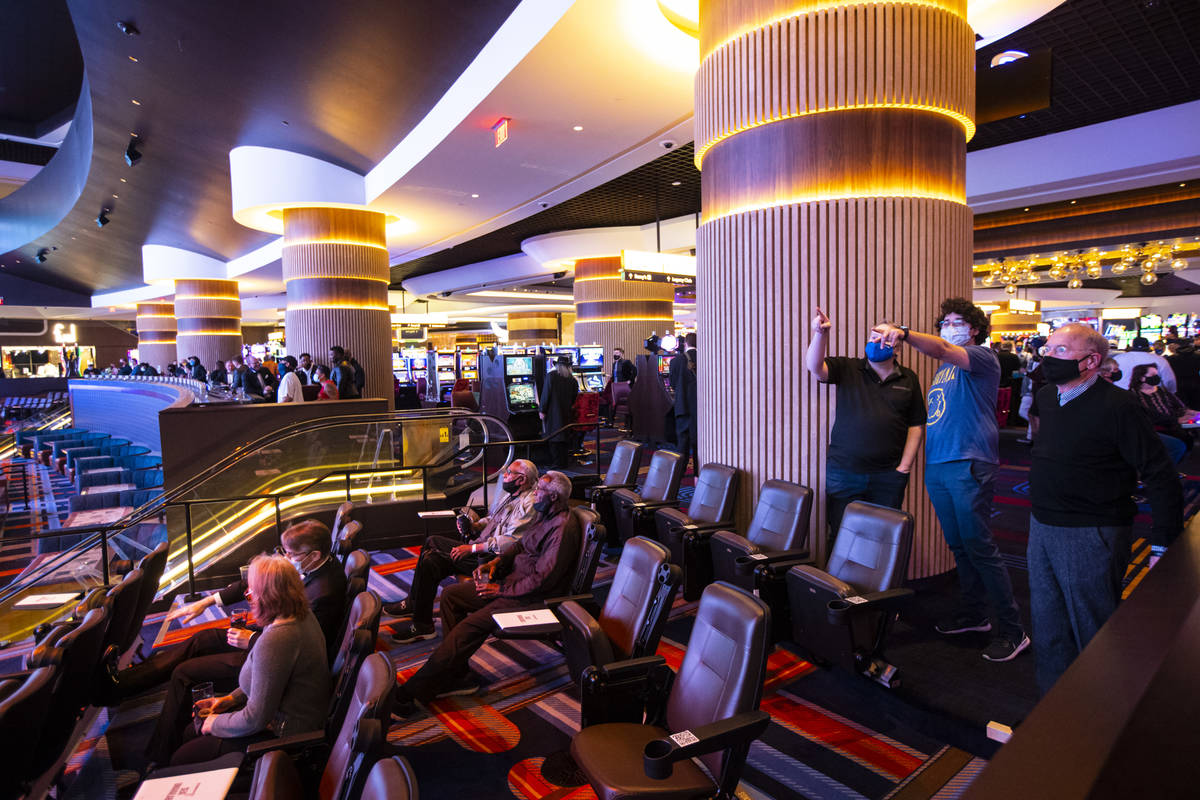 People check out the Circa Sportsbook as it opens to the public just after midnight in downtown ...
